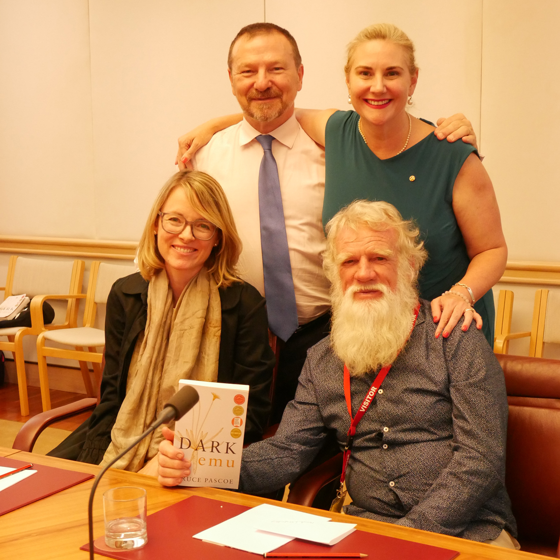 Bruce Pascoe and Anna Moulton from Magabala with Grahame and Hollie, holding the Dark Emu book