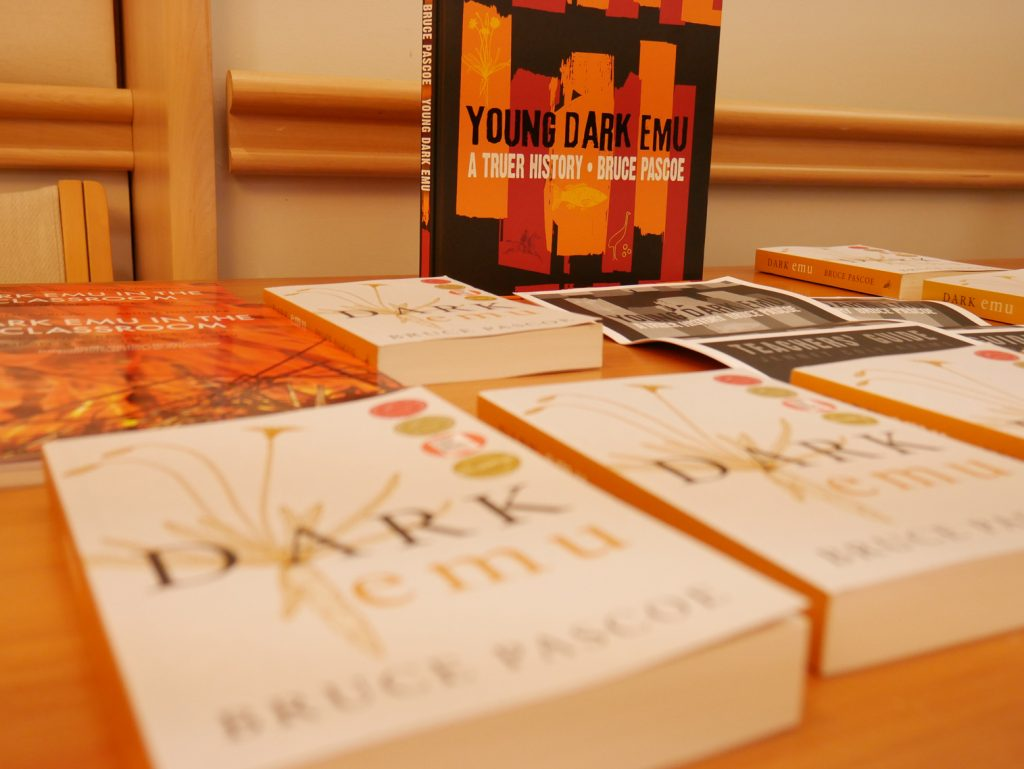 A spread of the books Dark Emu, Young Dark Emu, Dark Emu In The Classroom spread out on a table
